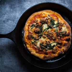 Fontina, Spicy Fennel Sausage, and Dandelion Greens Pizza