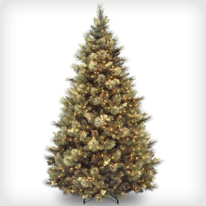 arolina Pine Tree, Hinged, 86 Flocked Cones, 750 Clear Lights