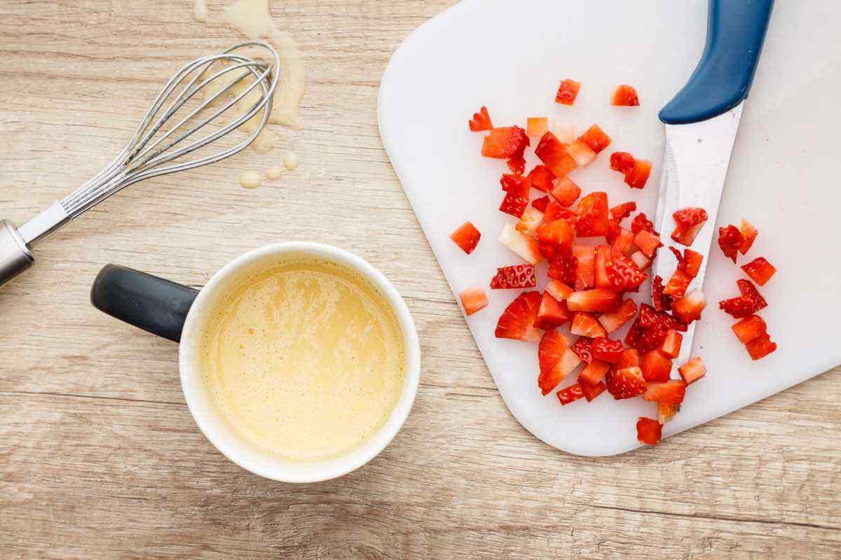 Vanilla Mug Cake with Whipped Cream and Fresh Strawberries